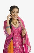 image of salwar  - Woman wearing a salwar kameez and talking on a mobile phone - JPG