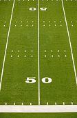stock photo of football field  - Empty American football field showing 50 yard line - JPG
