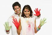 foto of holi  - Couple showing their colored hands on Holi - JPG