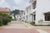 picture of karnataka  - Row of houses on the both sides of a tiled road - JPG