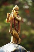 stock photo of lakshmi  - Statue of lord Krishna in a garden - JPG