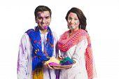 image of holi  - Couple celebrating Holi with Holi colors - JPG
