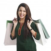 image of salwar  - Portrait of a happy woman carrying shopping bags - JPG