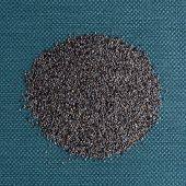 image of opiate  - Top view of poppy seeds against blue vinyl background - JPG