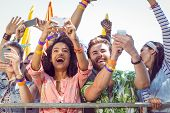 foto of exciting  - Excited music fans up the front at a music festival - JPG