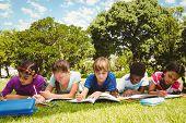 stock photo of homework  - Portrait of children doing homework at the park - JPG
