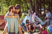 picture of gathering  - Hipster couple having fun on campsite at a music festival - JPG