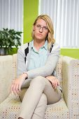 stock photo of frown  - Pretty student frowning at camera at the university - JPG