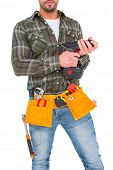 picture of hammer drill  - Manual worker holding gloves and hammer power drill on white background - JPG