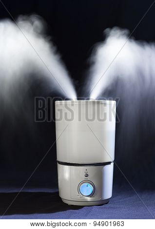 Humidifier Spreading Steam In  Darkness