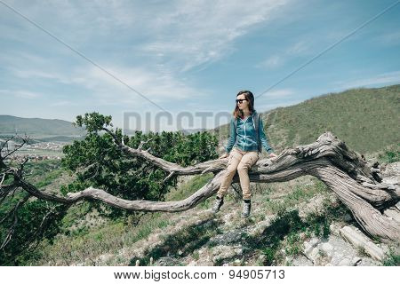 Traveler Young Woman Resting On Tree In Summer