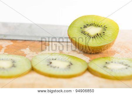 Closed Up Sliced Kiwi Fruit On Wood Floor