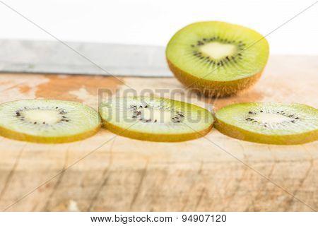 Sliced Kiwi Fruit On Wood Floor
