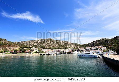 Beautiful small Sardinian port Poltu Quatu and mountains