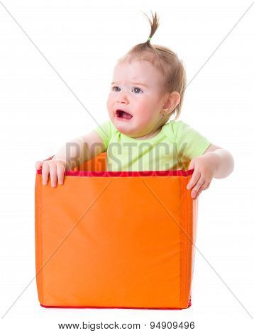 Crying Baby Girl Sitting In Box