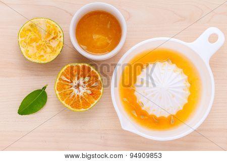 Freshly Orange Juice With Orange Slice Set Up On Wooden Table .