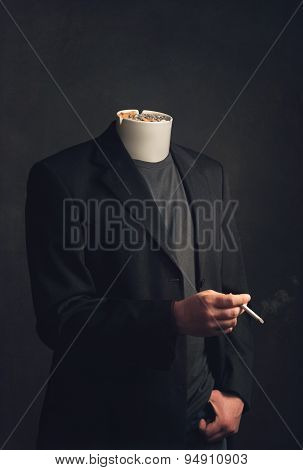 Headless Man With Ashtray Smoking A Cigarette