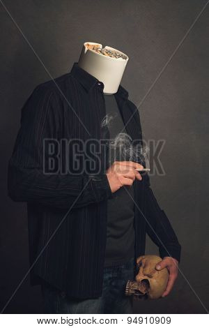 Headless Man With Ashtray And Skull Smoking A Cigarette
