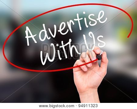 Man Hand writing Advertise With Us with black marker on visual screen.