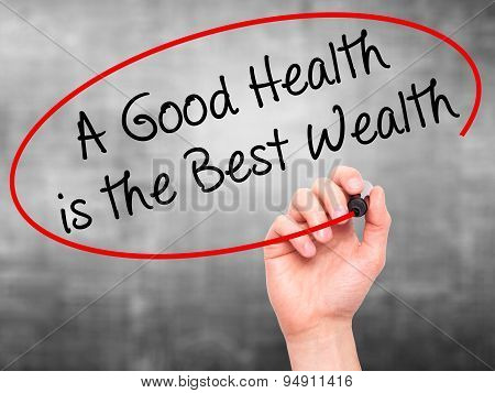 Man Hand writing A Good Health is the Best Wealth with black marker on visual screen.