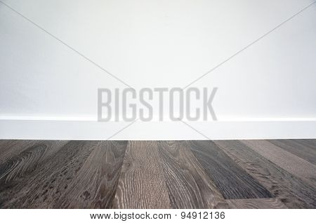 Laminate Floor And White Wall