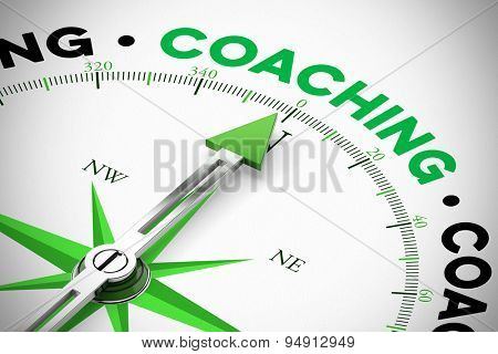 Arrrow of compass pointing to the word Coaching (3D Rendering)