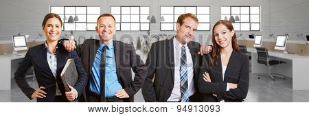 Happy Business people team in front of office space with computers