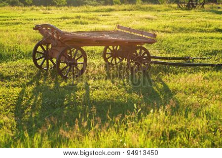 Rural landscape with old wooden cart
