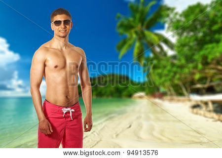Man on beach with palm tree at Seychelles, Praslin, Cote d'Or. Collage.