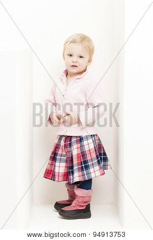 little girl wearing skirt