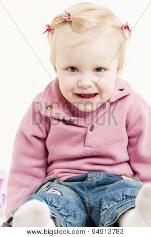portait of sitting little girl wearing jeans