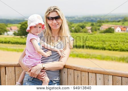 portrait of mother with her daughter in summer