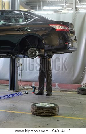Car in a dealer repair station