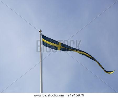 Swedish Pennent Waving On Flagpole