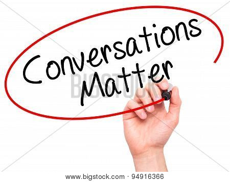 Man Hand writing Conversations Matter with black marker on visual screen.