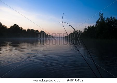 spinning rods in front of sea water