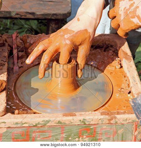 Potter Makes On Pottery Wheel Clay Pot.