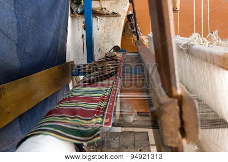 Authentic Weaving Machine, Which Weave Patterns On Fabric Tunisian Weavers. Mahdia. Tunisia. Africa.
