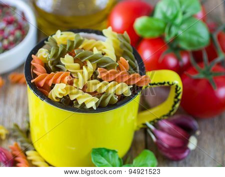 Colored pasta from wheat, spinach and tomatoes