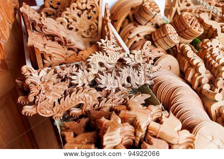 Carved Wooden Figures Of Dragons And Other Symbols Of Luck And Wealth For House Decoration.