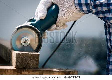 Carpenter Using Saw Tools Electric Cutting Wood