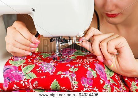 Seamstress Sew Fabric On The Sewing Machine.