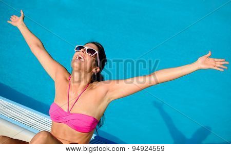 Blissful Woman Enjoying Summer Vacation At Swimming Pool