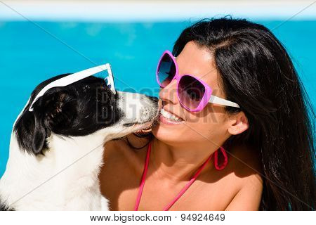 Woman And Cute Dog Having Fun On Summer Vacation