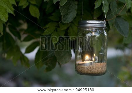 mason jar hanging on a tree