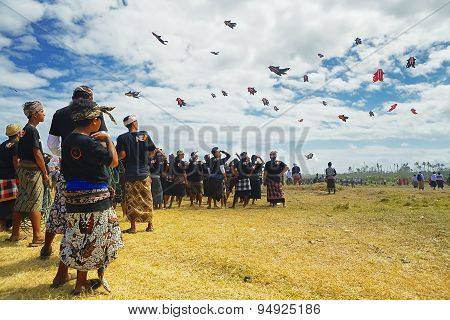 BalineseMen Looking At Group Of Flying Kites