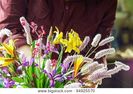 Woman working with various flowers