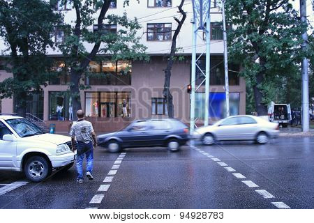 Drunk Man Crossing Road In The Rain