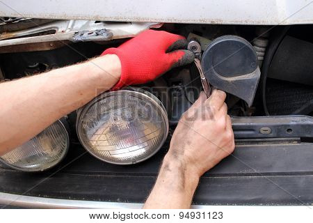 Technician Fixing Old Broken Car