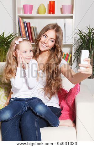 Happy Mother And Child Taking A Picture